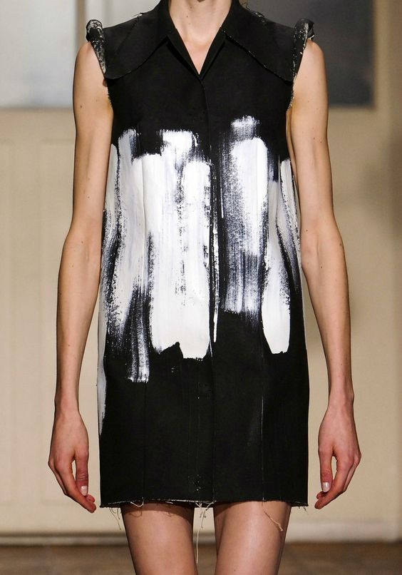"""Maison Martin Margiela's simple boxy silhouette with rough brush strokes, and unfinished hemline all quietly suggest, """"why bother? Who cares? It doesn't matter."""""""